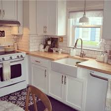 white country kitchen with butcher block. Kitchen White Appliances Subway Tile Farmhouse Sink Wood Countertop Dumb Waiter In Corner To Put Food Country With Butcher Block 0