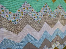 Chevron Baby Quilt Tutorial | Triangles on a Roll & Your Chevron Baby Quilt is now complete! Adamdwight.com
