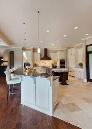 tile to hardwood transition roman patterned tile hard wood flooring white bar with black granite countertop