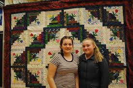 Memories of Resettlement theme of quilt show | Living | The Norwester & <p>Madison O'Keefe, age 13 and Aliya Guy, age 12 Adamdwight.com