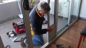 pet door insert installation in double sliding doors with wheels at the bottom