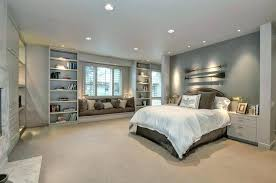 bedroom built ins contemporary master with 3 drawer nightstand stone fireplace carpet kitchen cabinets tv buil