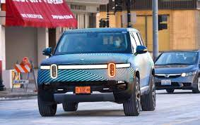 How Rivian plans to build Tesla-like ...