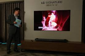 lg e7 oled. additionally, lg will include dolby atmos in all five oled tvs. w7 have the dedicated soundbar that has roof-firing speakers, whereas e7 and g7 lg oled