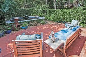 exterior terracotta tile paint. traditional patio with pond, exterior tile floors, terracotta floors paint