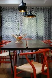 orange chairs with white dining room and baby blue accents blue accents tom dixon