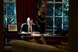 white house oval office desk. President Obama Working At The Resolute Desk In Oval Office On October 18, 2013. White House