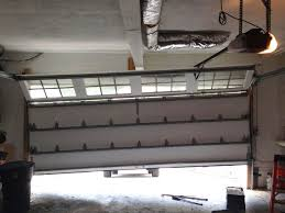 garage door off trackOut of tracks garage door repairs Los Angeles CA