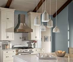 unique island lighting. a unique mix of feiss dutch pendants hung at different heights to create and visually interesting lighting focal point island l