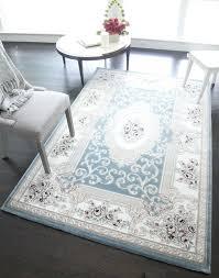 cowhide rug american furniture warehouse rugs light blue area reviews