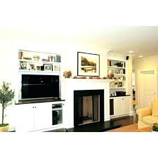 fireplace tv stand canada next to design ideas natural stone with wall designs beside living tv fireplace opposite walls great idea