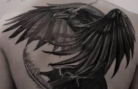 значение тату ворон мрачный но символичный