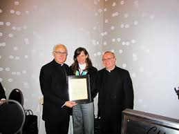 saints peter paul church host annual gratitude gala to honor or zimmer center presents a proclamation to bishop thomas a donato left