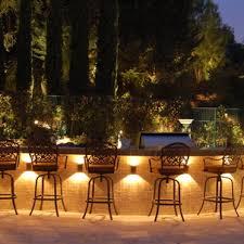 tropical outdoor lighting. Custom Landscape Lighting Storm Omaha Lush Tropical Driveway Irrigation Tree Palm Naples Illuminate Outdoor