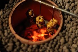 en cooking in the tandoor