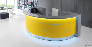 white and yellow half circle reception desk