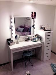 furniture rectangle white wooden makeup vanity with drawer next to white wooden chest of drawer