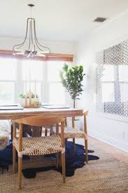 huge neutral wall art fashiontoast s rumi neely gets an la retreat the plants add soothing color and allmodern dining chairs give the room a laid back