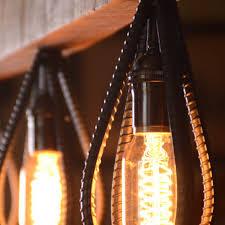 barn wood and rebar light fixture by rebarn designs upcycledzine