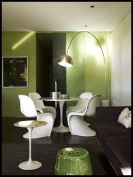 green dining room with panton chairs tulip table arco l
