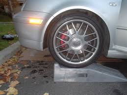 after i propped the car on ramps i secured the back wheels und and took off the black bottom part which btw was never taken off by the dealer
