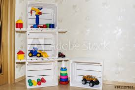 kids room wallpaper and wooden crates in an environmentally friendly shelves for toys