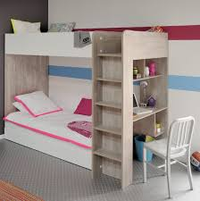 fluffy white bedding on wooden bunk bed with desk and ladder on grey carpet