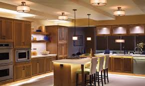overhead kitchen lighting. this modern kitchen has overhead cabinet lights as well several hanging lighting a