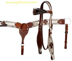 headstall features leather cross and small sunflower conchos on wide browband and cheeks tcollar features leather cross and small sunflower conchos