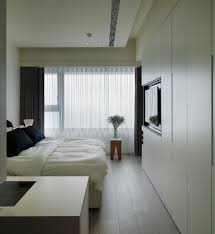 Modern Bedroom Storage Modern Bedroom With Fitted Wardrobe And Using Multiple Curtains