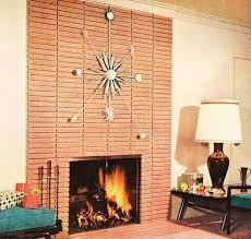 atomic starburst clock on modern brick fireplace mid century modern