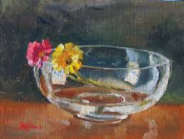 gerbera daisies in a glass bowl sold