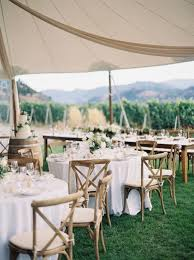 chic wedding reception table arrangement ideas for a tented wedding