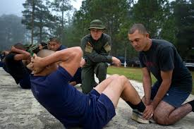 u s department of defense photo essay a n national policeman grades a honduran commando doing sit ups during a diagnostic physical