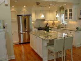 kitchen backsplash with black granite countertops and white cabinets