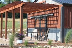 brown pergola plans with two props ideas with chair and table plus flowers for backyard decor