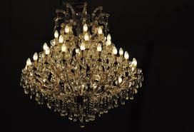 inspiring chandelier candle diy crystal hinging black background light beautiful elegant real chandeliers amusing fascinating lighting white wall seat table