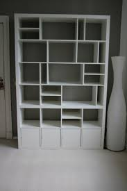 white Ikea Expedit bookcase with storage at bottom ideas with grey wall  plus white jar and