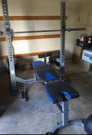 nautilus folding bench press squat rack olympic bars and weights in tukwila wa offerup