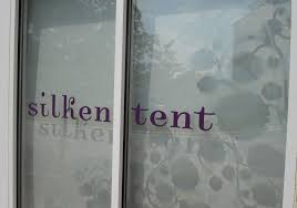 door purple and frosted vinyl on front windows gray lettering