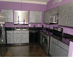 black countertop and purple wall decor for kitchen ideas kitchen