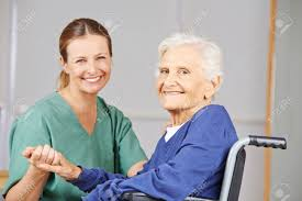 Geriatric Nursing Geriatric Nurse And Senior Woman In Wheelchair Smiling Together
