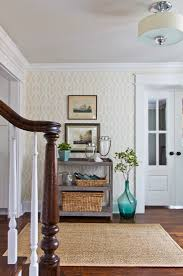 A small entryway means you can get away with a bold accent wall. Patterned  wallpaper adds definition to a meager foyer and yields instant personality  that ...