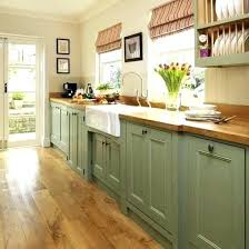 green countertop green kitchen green cabinets w butcher block and farm sink green granite kitchen counters
