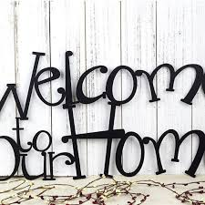 welcome to our home metal wall art 24x12 matte black