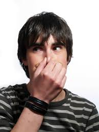 guy holding his nose because of bad odors
