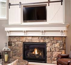 mini barn door sliding doors over fireplace classy way to cover tv
