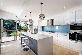 kitchen blue glass backsplash. Beautiful Blue White Coastal Kitchen Decor With Cabinet And Blue Sky Glass  Backsplash Facing Countertop Island Under Three Pendant  L