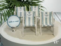 5 inspiring ideas for a beach themed wedding reception the Beach Themed Wedding Place Cards beach themed wedding weddingstar beach chair escort card display beach themed place cards for wedding