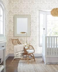 girl nursery pink elephant wallpaper rattan chair white crib serena lily brass floor lamp jute rug wood floors